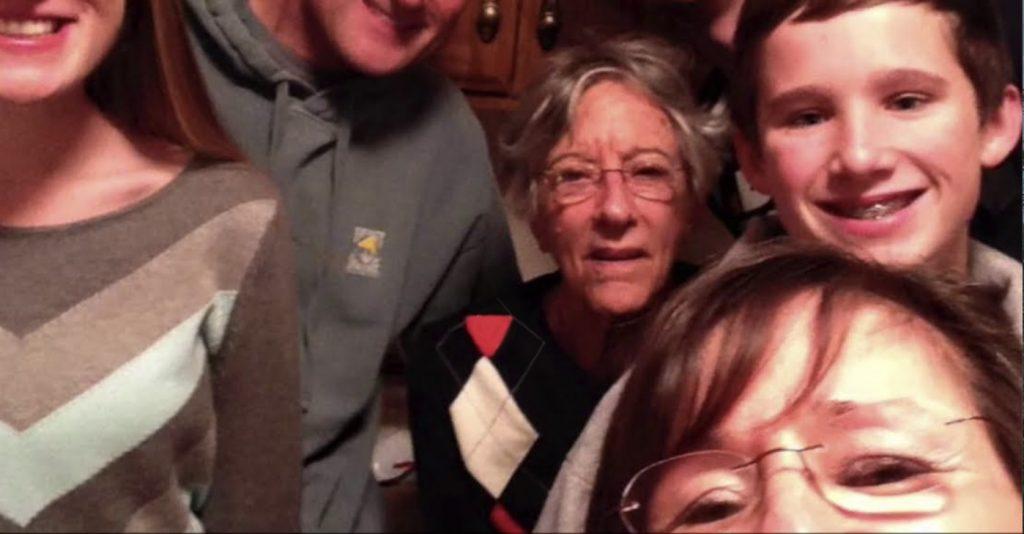 Charter Senior Living of Panama City Beach Video Thumbnail Family Group Surrounded by senior living resident